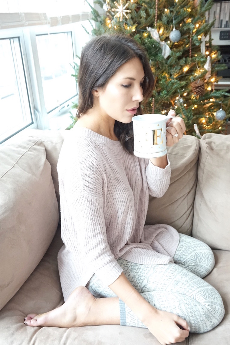 sipping coffee by christmas tree